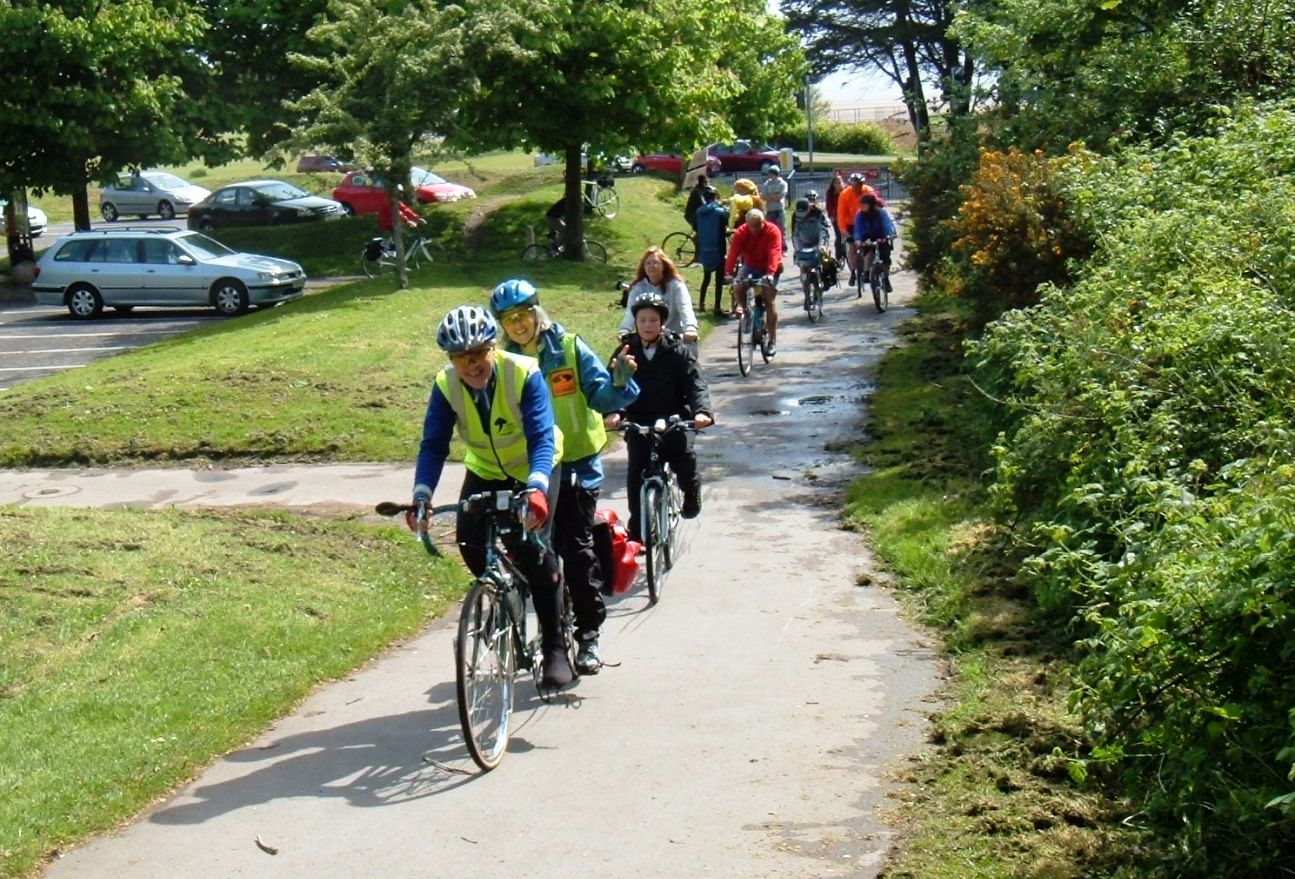 Cyclists head up the Clyne Valley.