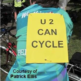 """U2 can cycle"" on cyclist's back."